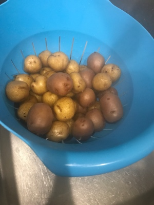 Drain those potatoes! Then put them back in the pot and smash them!